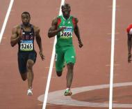 Francis Obikwelu e Tyson Gay na meia-final olímpica dos 100m
