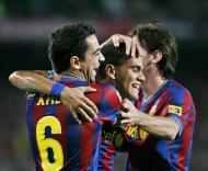 Messi e Xavi festejam golo de Dani Alves ao At. Madrid