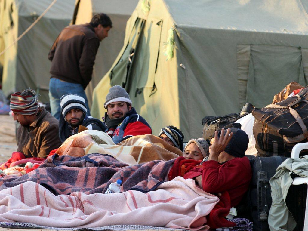 Refugiados líbios na Tunísia [EPA]