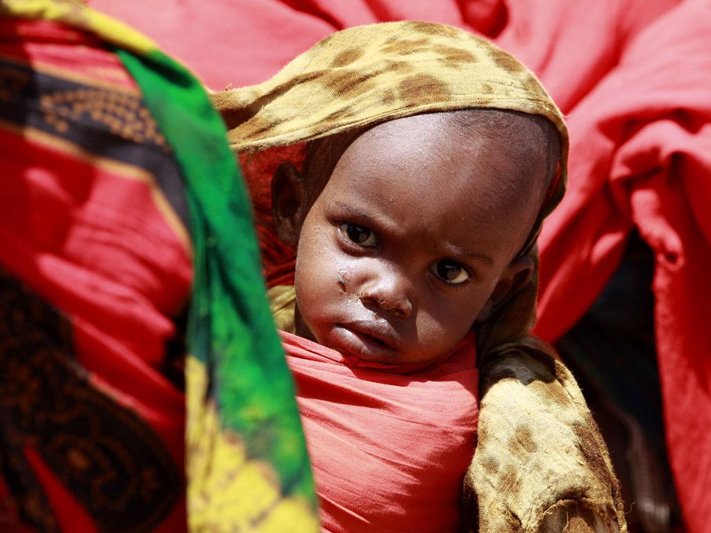 Criança no campo de refugiados de Dadaab, no Quénia (Thomas Mukoya/Reuters)