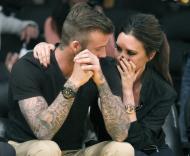 David e Victoria Beckham apaixonados em jogo de basquetebol Fotos: Reuters