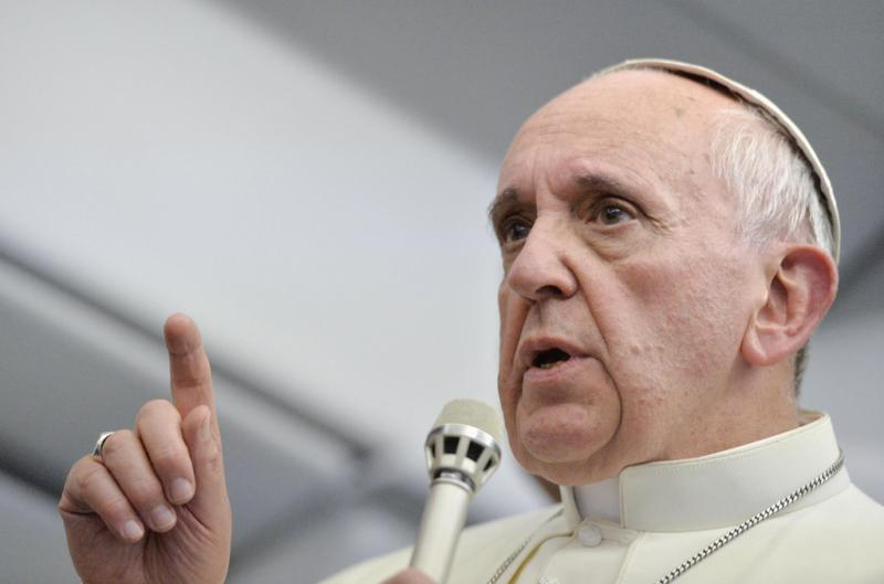 Papa Francisco fala com os jornalistas Foto: Reuters