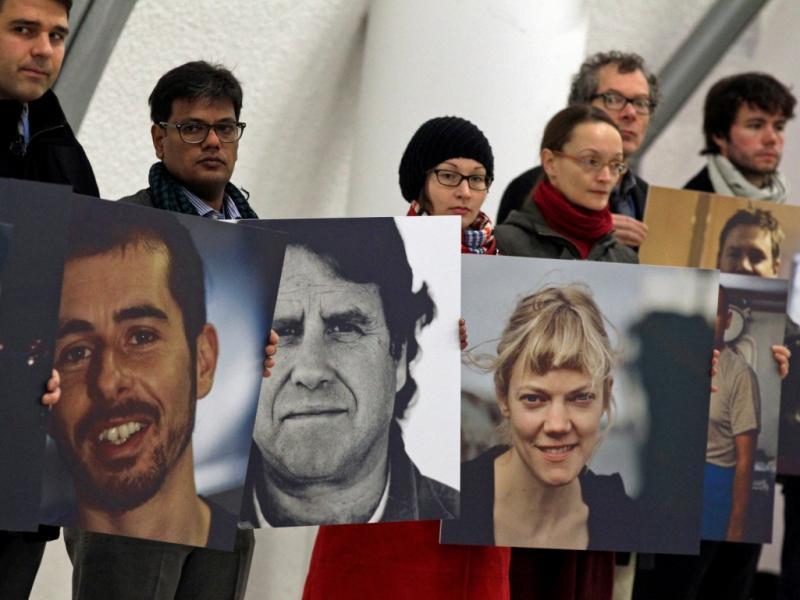 Manifestação a apoio aos ativistas da Greenpeace detidos em Moscovo durante a cimeira do clima de Varsóvia (Reuters)
