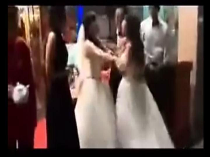 Vídeo mostra mulher a aparecer no casamento do amante e a atacar a noiva (Foto: Reprodução/YouTube)