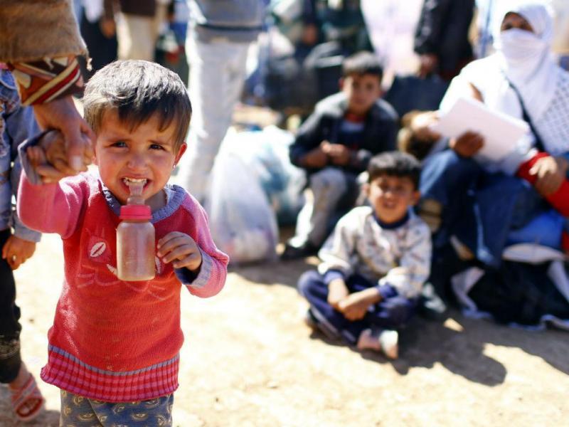 Refugiados sírios na fronteira com a Turquia (EPA/LUSA)