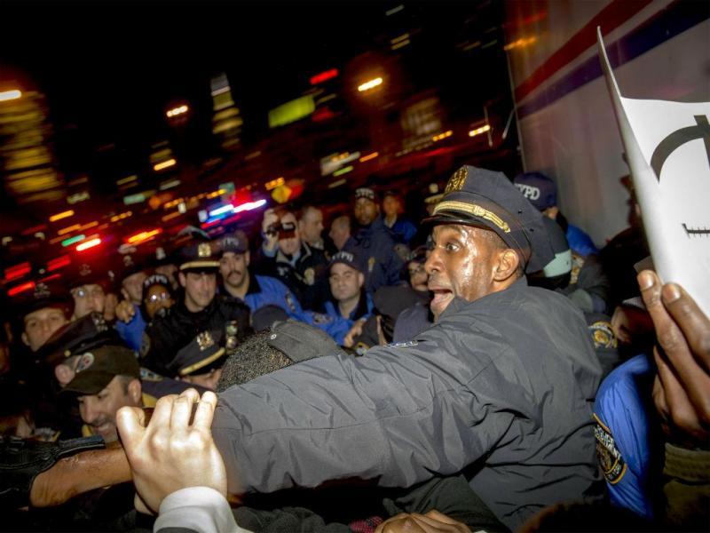 Protestos após ilibação do polícia Darren Wilson (REUTERS)