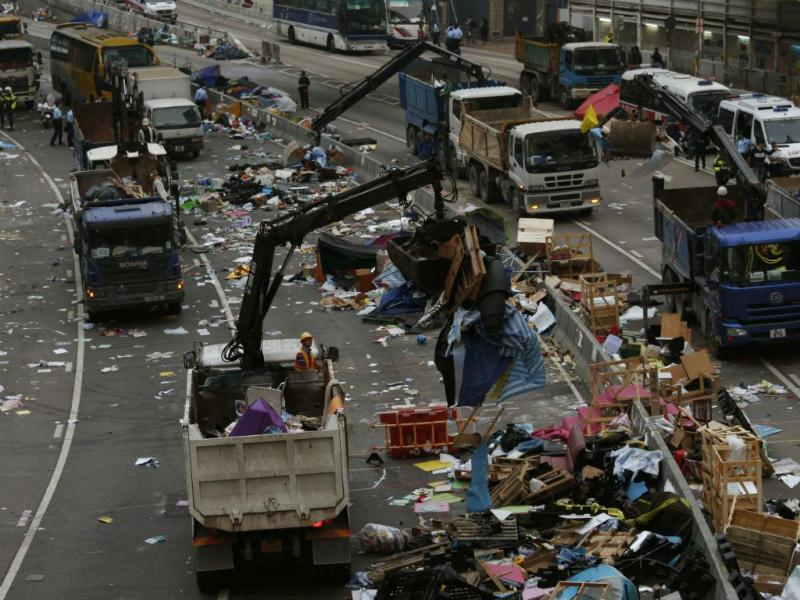 Limpeza das ruas de Hong Kong (REUTERS)