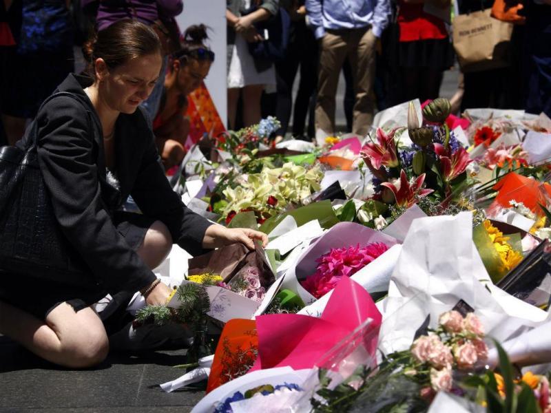 Homenagem às vítimas do sequestro em Sidney (Reuters)