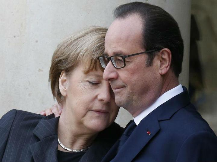 Angela Merkel e François Hollande na marcha de solidariedade em Paris (Reuters)