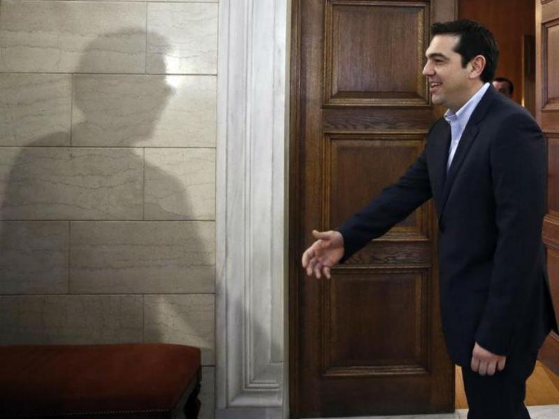 Jeroen Dijsselbloem e Alexis Tsipras [Foto: Reuters]