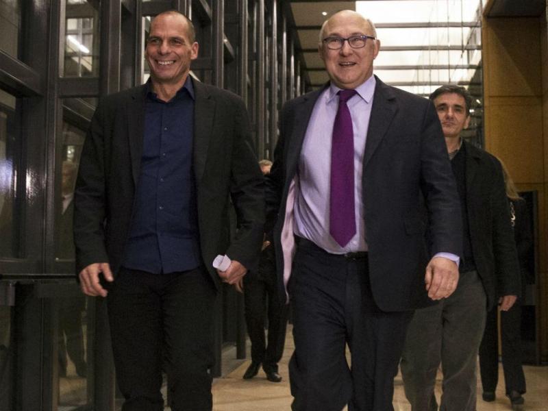 Yanis Varoufakis e Michel Sapin [Foto: EPA]