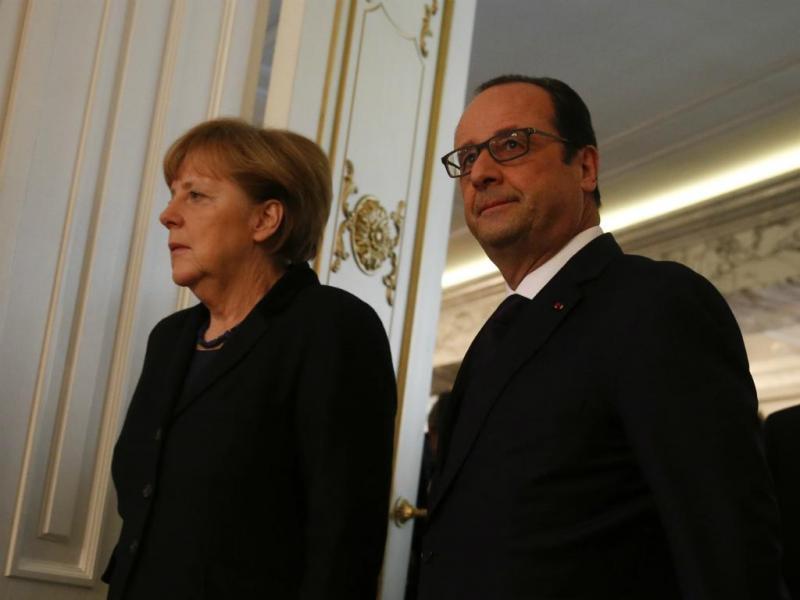 Angela Merkel e François Hollande - Encontro de Líderes em Minsk [Reuters]