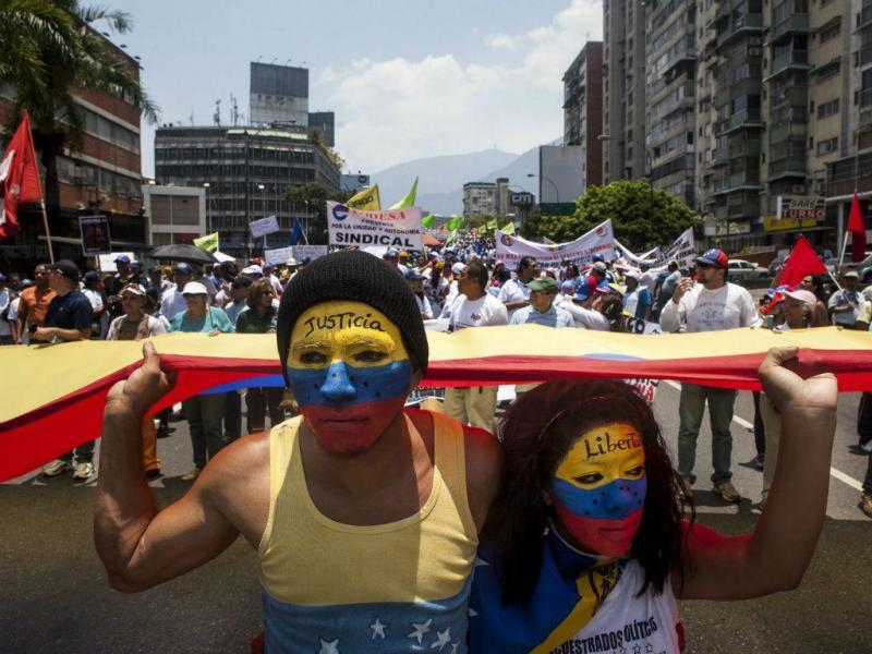 O 1.º de Maio na Venezuela [Lusa]