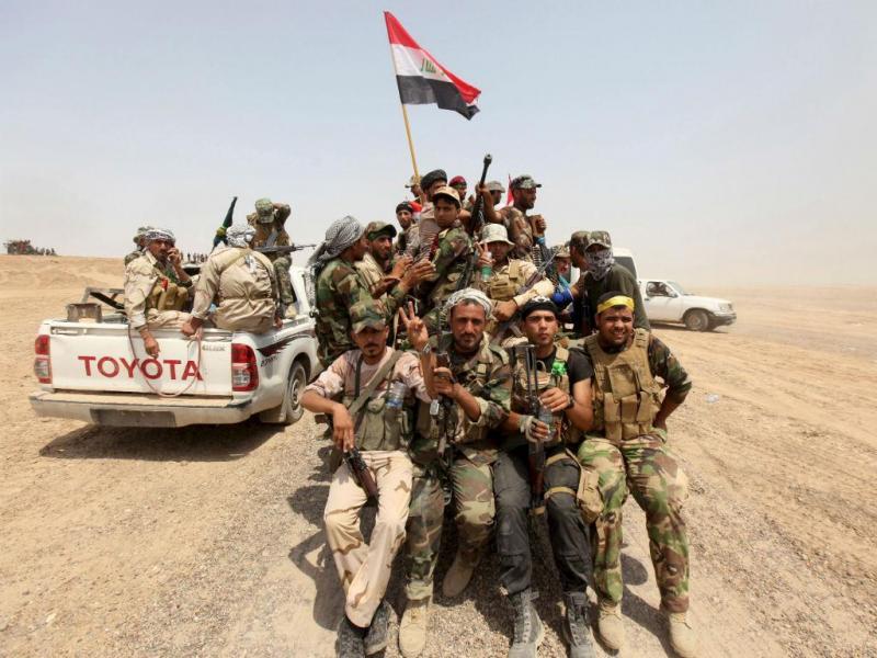 Milícias paramilitares xiitas pró-Governo iraquiano na província de Anbar (Reuters)