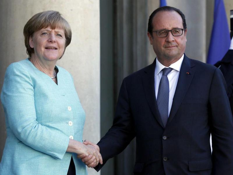 Merkel em Paris com Hollande (Lusa)