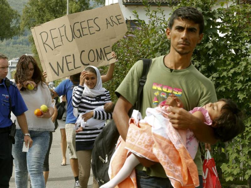 Refugiados sírios chegam a Buchs, na Suiça - Setembro de 2015 (REUTERS/Arnd Wiegmann)