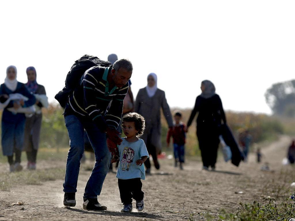 Migrantes e refugiados (Reuters)