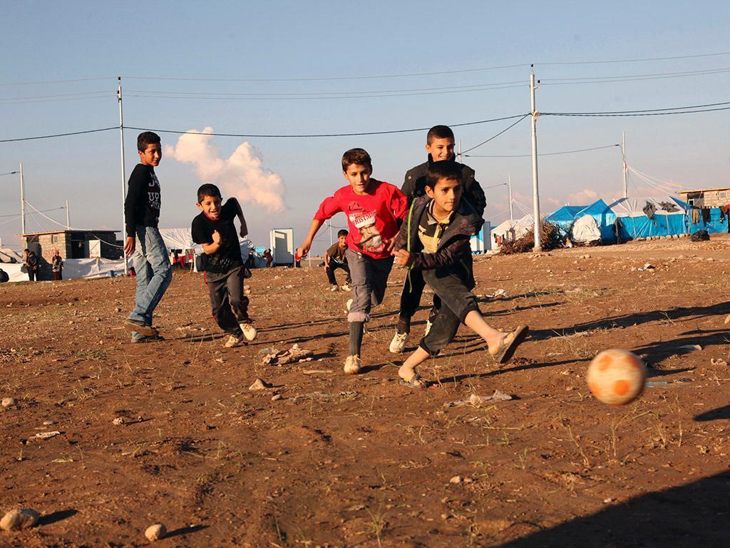 Refugiados e o futebol (REUTERS)