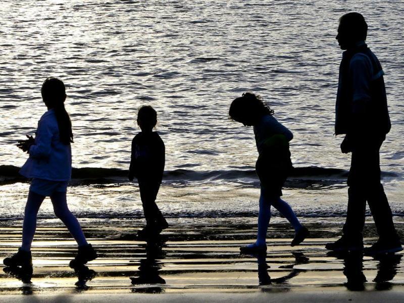 A felicidade de uma família de refugiados em Portugal [Foto: Lusa\João Relvas]