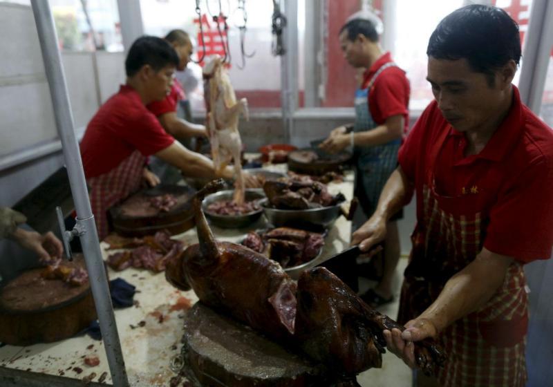 Festival de carne de cão na China [Foto: Reuters]