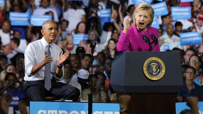 Barack Obama e Hillary Clinton juntos numa ação de campanha da candidata