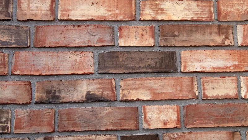 Família alemã parede de tijolos