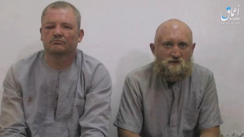 Alegados soldados russos detidos pelo Daesh (AMAQ)