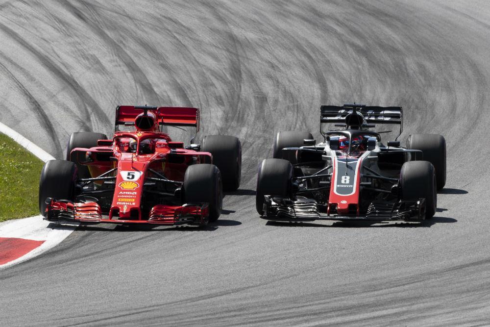 Sebastian Vettel e Romain Grosjean (Lusa)