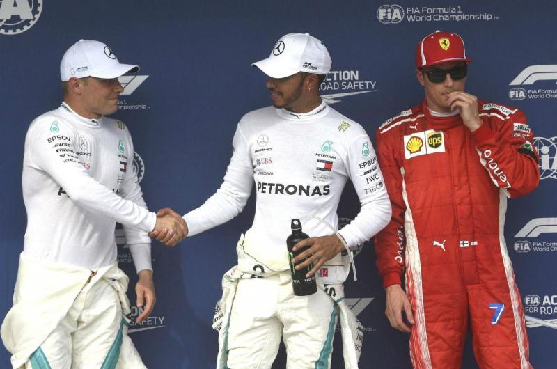 Bottas, Hamilton e Raikkonen (Lusa)
