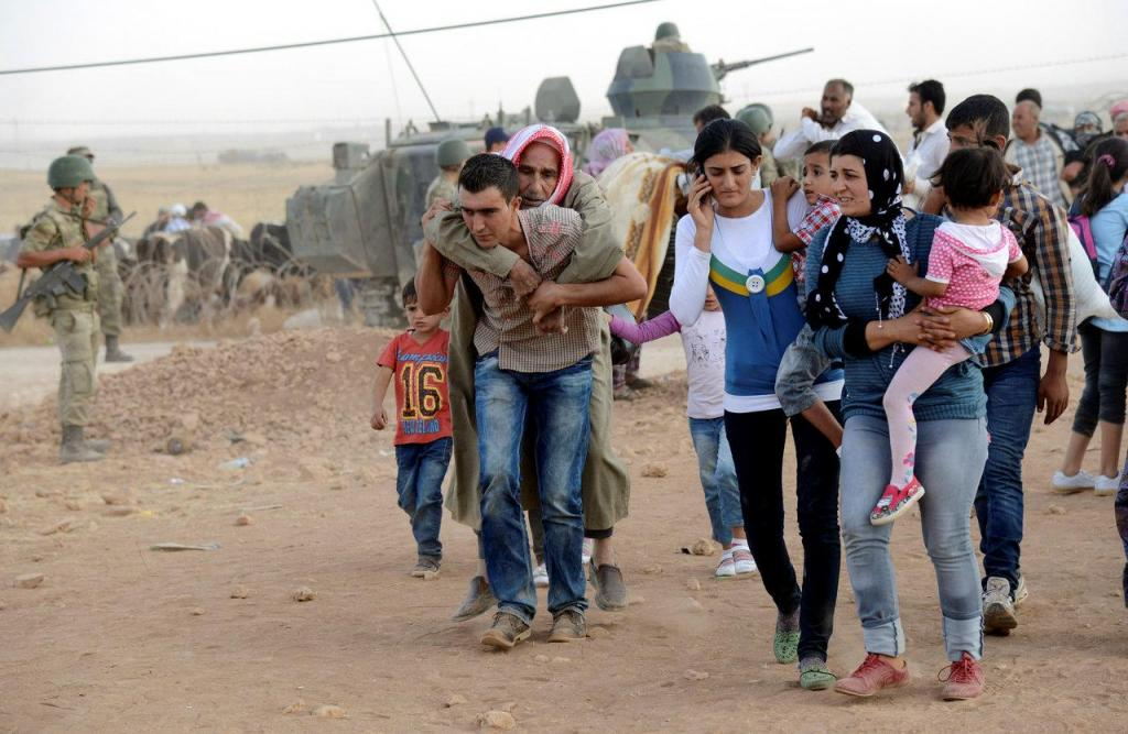 Síria - refugiados entram na Turquia