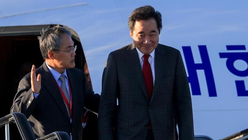 Woo Yoon-keun e o primeiro-ministro sul coreano Lee Nak-yon