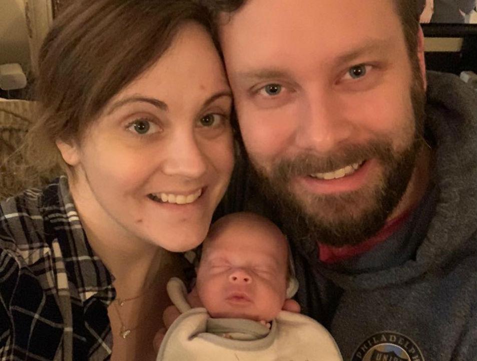 Jennifer e Drew Gobrecht com o filho Benjamin