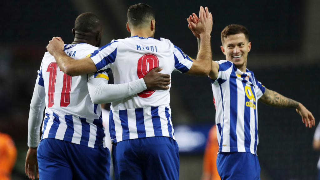 Taremi festeja com Marega e Otávio o 1-0 no FC Porto-Juventus (Estela Silva/LUSA)