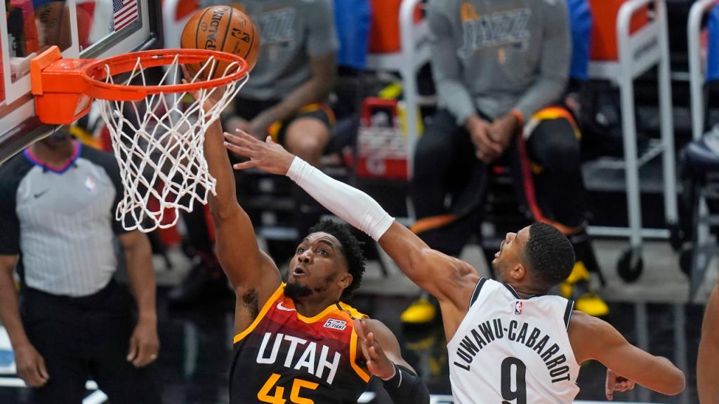 Utah Jazz-Brooklyn Nets: Donovan Mitchell e Timothe Luwawu-Cabarrot (Rick Bowmer/AP)