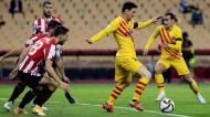 Lionel Messi perante Óscar de Marcos no Athletic Bilbao-Barcelona, da final da Taça do Rei (Julio Munoz/EPA)