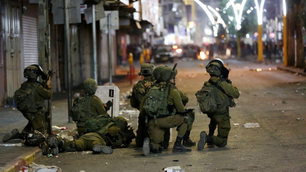 Confrontos entre palestinianos e o exército israelita em Hebron, na Cisjordânia