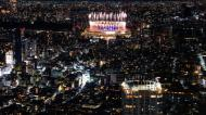 Fireworks illuminate over National Stadium during the closing ceremony of the 2020 Tokyo Olympics, seen from the Shibuya Sky observation deck, Sunday, Aug. 8, 2021, in Tokyo. (AP Photo/Kiichiro Sato)