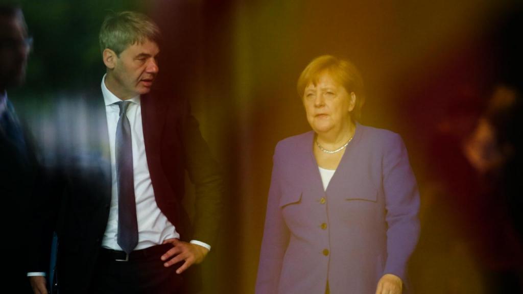 Jan Hecker com Angela Merkel