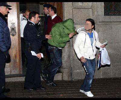 Porto: suspeitos saem do TIC - Foto de João Abreu Miranda para Lusa